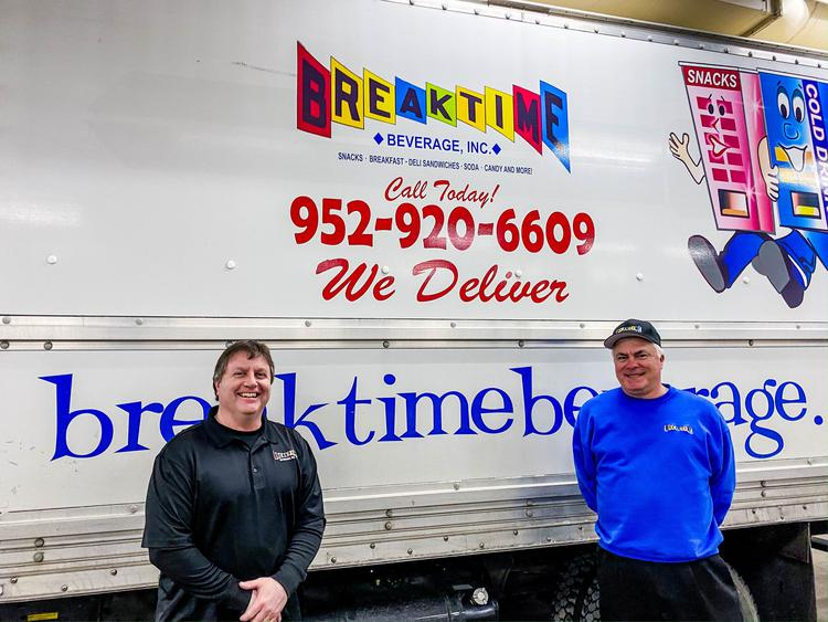 Breaktime Beverage staff standing next to one of their delivery vans.